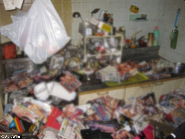 The kitchen of the Japanese man whose body was recovered from under a six-ton pile of porn